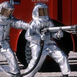 800px-Fire_fighters_practice_with_spraying_equipment,_March_1981