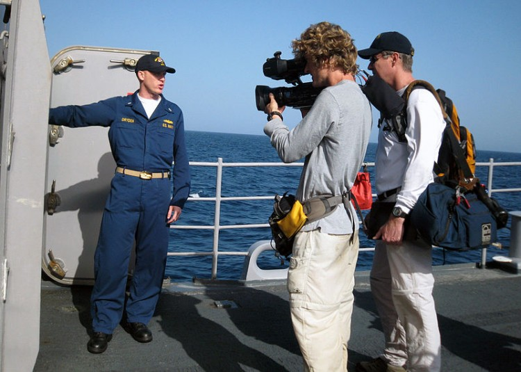 US_Navy_090321-N-7569G-001_Lt._j.g._Matthew_Dryden_leads_a_Discovery_Channel_film_crew_on_a_tour_of_the_guided-missile_cruiser_USS_Vicksburg_(CG_69)_for_the_three-part_series