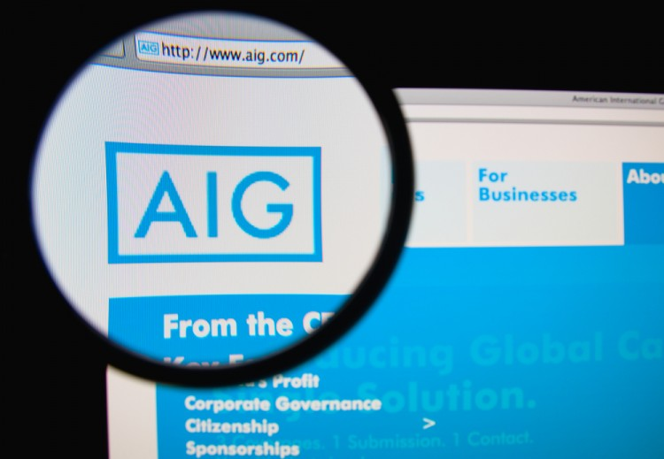 American International Group Inc (NYSE: AIG), homepage, website, close up, magnifying glass, symbol, logo
