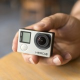 GoPro Inc (NASDAQ:GPRO), Camera, Hero 4, Hand holding, Isolated