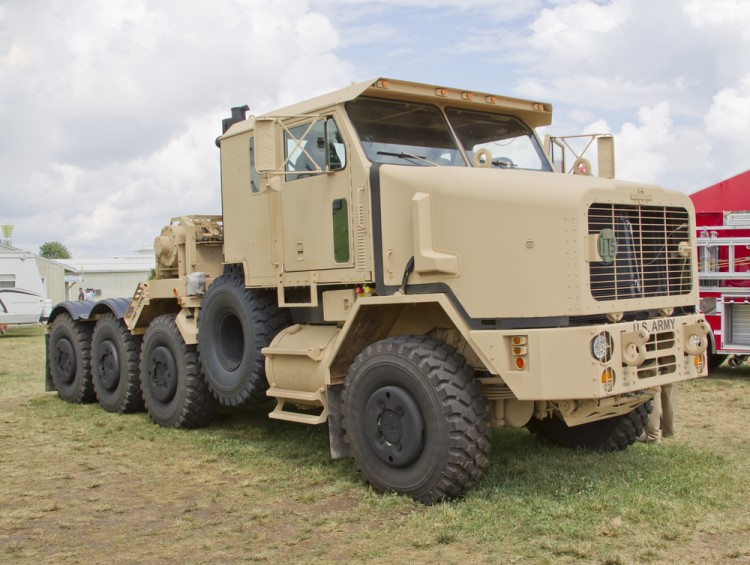 best defense stocks to buy for 2021 Oshkosh OSK Army Truck Pentagon