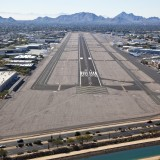 runway, aerial, landing, airport, planes, wings, off, take, airplanes, corporate, mountains, canal, engines, elevation, saguaro, jets, buildings, cactus, water, taxiway, hangers