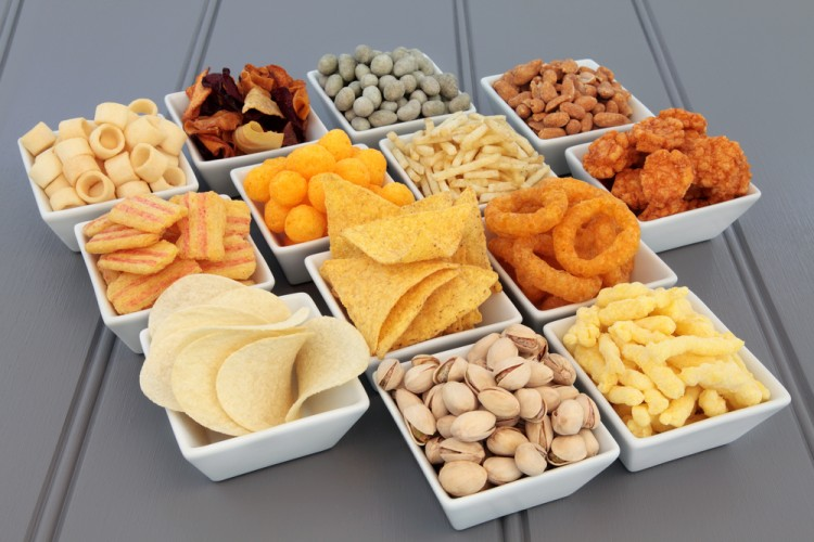 Savory snack party food selection in square porcelain bowls.