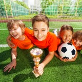 sport, child, gate, many, fun, park, green, row, boy, ball, arm, grass, goblet, football, group, childhood, uniform, game, net, prize, field, win, laying, lay, cup, active, summer,