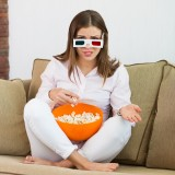 angry, annoyed, attractive, beautiful, bowl, brown, caucasian, cinema, corn, disappointed, dissatisfied, eating, enjoying, film, girl, glasses, hair, home, indoor,