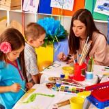 kindergarden, teacher, desk, kindergarten, nursey, chair, table, club, children, preschool, craft, yellow, classroom, bright, decor, nursery, drawing, people, paint, class,