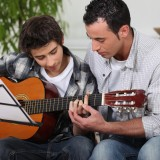 lesson, guitar, music, teaching, kid, father, learn, playing, child, son, boy, adult, youth, instrument, musician, young, guitarist, caring, fatherhood, two, fun, closeness,