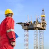 oil, rig, gas, worker, engineering, engineer, platform, drill, drilling, man, pipe, roughneck, helmet, tall, plant, sky, fuel, clipboard, steel, coveralls, facility, incomplete, power,
