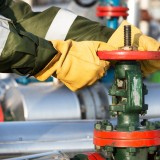 gas, fuel, handsome, manual, technician, glasses, coveralls, hat, machinery, red, valve, pipeline, pump, field, jack, crude, drilling, engineer, black, technology, smiling,