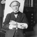 Original Caption: 2/27/1918-Houdini showing how to slip handcuffs.