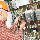 VPG electrician working with meter