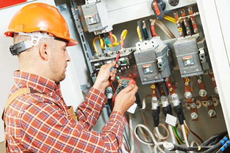 electrician working with meter