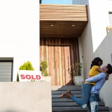 abode, affection, apartment, attractive, casual, caucasian, couple, domestic life, domicile, embracing, female, handsome, happiness, happy, home, homeowner, homey, house, household, hugging, leisure, lifestyle, love, male, man, moving, moving house, new, placard, portrait, real estate, relationship, relocating, relocation, shirt, sign, sold, standing, together, white, woman, young adult
