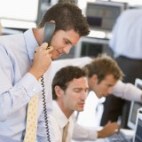 Insider Trading, NYSE, Markets, Stock Trader On The Phone